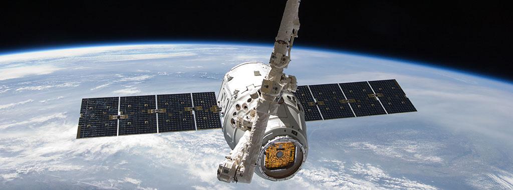 Space X Dragon, by NASA